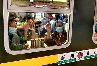 Na Kitajskem, v Wuhanu, turisti potujejo z vlakom